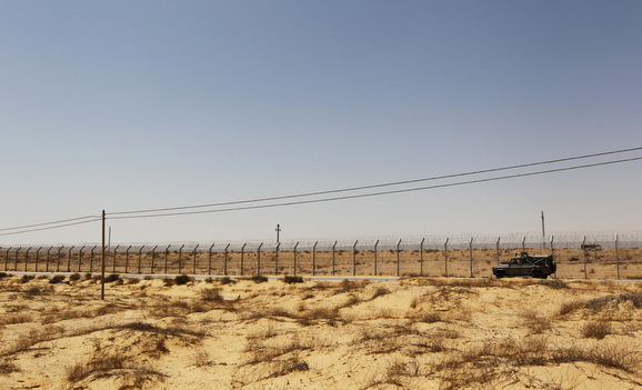 An Israeli military vehicle drives along Israel's border with Egypt's Sinai desert, near the Nitzana crossing