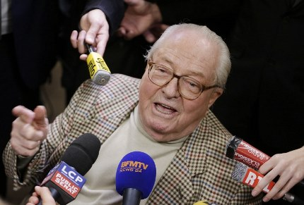 French far-right Front National (FN) party honorary president Jean-Marie Le Pen speaks to journalists following the anouncement of results for the first round of the French departementales elections on March 22, 2015 in Nanterre. AFP PHOTO / KENZO TRIBOUILLARD